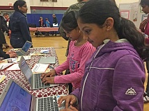 SUBMITTED PHOTO: DEANNE CRONE KNIPPLE - Yasaswini Sura, 8, and Nitya Kamidi, 7, edit and update their coding projects at the Evening of STEAM on March 9 at Oak Creek Elementary School.