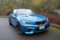 PORTLAND TRIBUNE: JEFF ZURSCHMEIDE - The 2017 BMW M2 bodywork defines its sports car personality, with big fender flares to cover the substantial tire footprint on 19-inch wheels.