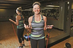 PAMPLIN MEDIA PHOTOS: VERN UYETAKE - Caren Pennington has been training at Fit For Life for more than 20 years, and says the key to each of her four classes is a loose, family-like environment.