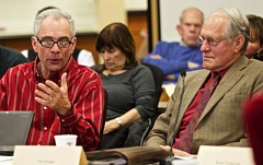 FILE - Mayor Lou Ogden, left, and Tim Knapp, right, of Tualatin and Wilsonville respectively, discuss Basalt Creek planning at a December 2015 meeting. Comity between the cities appears to have broken down, with Knapp forcefully rejecting an adjustment to the land use concept map sought by Tualatin this winter.