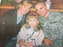 ARCHIVE PHOTO - Jeremy Loveless sits with his wife Melissa and daughter Chloe. In 2006, Loveless was killed while serving with the U.S. Army in Iraq, and Southeast Fifth Avenue was recently renamed in his honor.