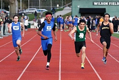TRIBUNE PHOTO JONATHAN HOUSE - Grant High's Saivon Brown (second from left) edges the field in the 100-meter dash Wednesday afternoon at Wilson.