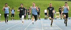 REVIEW PHOTO: MILES VANCE - Lakeridge's Cameron Russell (center) races to victory in the 100-meter dash against Lake Oswego on Wednesday afternoon at Lakeridge High School.