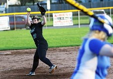 DAN BROOD - Tigard junior Ashley Davis (left) gets ready to fire in a pitch during the Tigers''game at Aloha. Davis threw a five-inning shutout, striking out nine batters. She also drove in three runs at the plate in Tigard's 10-0 victory.