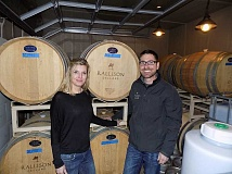 GAZETTE PHOTO: RAY PITZ - Jared and Lari Rallison, who grow grapes and bottle their Rallison Cellars wine atop Parrett Mountain (and shown here at that location), have opened a tasting room in Old Town Sherwood.