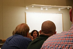 OUTLOOK PHOTO - Wood Village Mayor Tim Clark (left) listens to Fairview Councilor Natalie Voruz (center) discuss her concerns during a two-city meeting on Tuesday, March 21.