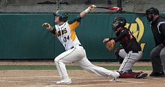 TIDINGS PHOTO: MILES VANCE - West Linn's Micah Gibson follows through after a swing during his team's 4-0 loss to Clackamas at West Linn High School on Thursday.
