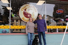 CONNECTION PHOTO: HANNAH RANK - Barb Cantonwine (left) and Michael Carroll outside their Southwest Troy Avenue  storefront with their dog, Meadow.
