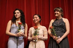 CONNECTION PHOTOS: HANNAH RANK - Rose Court princess nominees Alexis Scamarone (from left), Maggie Beutler and Taya Wyatt wait to hear who was selected at a ceremony in the Wilson auditorium on March 8.