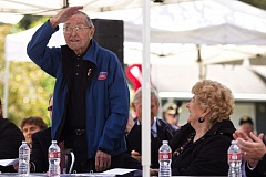 FILE - Curtis Tigard stands to be recognized at a Memorial Day event in 2014, at which he was recognized as the oldest living veteran in Washington County.