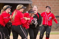 COURTESY PHOTO - Pacific players celebrate a win during a doubleheader split last weekend versus Whitworth.