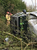 PHOTO COURTESY OF LAKE OSWEGO FIRE DEPARTMENT - Fire officials had to extricate a seatbelted driver from his vehicle after a rollover crash near Lake Oswego High School on Thursday afternoon. The driver was transported to a local hospital with injuries that officials said did not appear to be life-threatening.